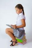 Muchacha elegante con la tableta Fotografía de archivo libre de regalías