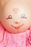 Muchacha embarazada con una imagen Imágenes de archivo libres de regalías