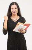 Muchacha emocionada con los libros Imágenes de archivo libres de regalías