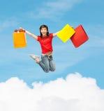 Muchacha emocionada con los panieres Imágenes de archivo libres de regalías
