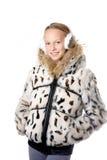 Muchacha en abrigo de invierno con las orejeras Fotografía de archivo libre de regalías