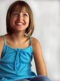 Muchacha en alineada azul Imagen de archivo libre de regalías