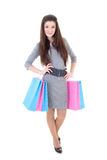 Muchacha en alineada con los bolsos de compras Fotos de archivo libres de regalías