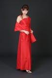 Muchacha en alineada roja Fotografía de archivo libre de regalías