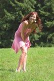 Muchacha en alineada rosada Foto de archivo libre de regalías