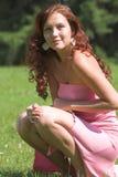 Muchacha en alineada rosada imagen de archivo libre de regalías