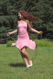 Muchacha en alineada rosada Fotografía de archivo