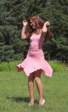 Muchacha en alineada rosada Imágenes de archivo libres de regalías