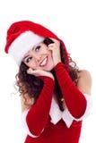 Muchacha en alineada y el sombrero rojos de santa Imagen de archivo libre de regalías
