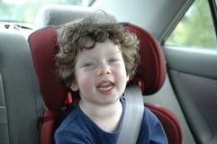 Muchacha en asiento de coche Fotos de archivo libres de regalías