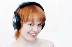 Muchacha en auriculares Imagenes de archivo