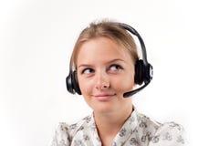 Muchacha en auriculares con el micrófono Imagen de archivo libre de regalías