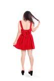 Muchacha en backshot integral del vestido rojo Imágenes de archivo libres de regalías