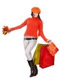 Muchacha en bolso de compras anaranjado de la explotación agrícola. Fotografía de archivo