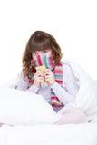 Muchacha en bufanda con las píldoras Imagen de archivo libre de regalías