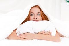 Muchacha en cama Imagen de archivo libre de regalías