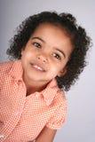 Muchacha en camisa anaranjada Imagenes de archivo