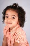 Muchacha en camisa anaranjada Fotos de archivo