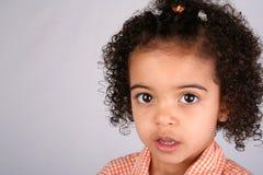 Muchacha en camisa anaranjada Fotografía de archivo libre de regalías