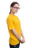 Muchacha en camiseta amarilla en blanco Imagen de archivo