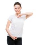 Muchacha en camiseta blanca en blanco Foto de archivo libre de regalías