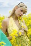 Muchacha en campo amarillo Foto de archivo libre de regalías