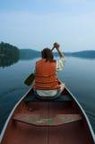 Muchacha en canoa Foto de archivo libre de regalías