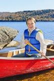 Muchacha en canoa Fotografía de archivo
