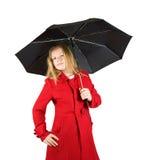 Muchacha en capa con el paraguas fotografía de archivo libre de regalías