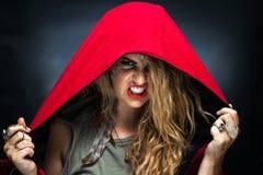 Muchacha en capilla roja y maquillaje Scowling Fotografía de archivo libre de regalías