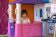 Muchacha en casa de juego Fotografía de archivo libre de regalías