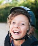 Muchacha en casco del montar a caballo Fotografía de archivo libre de regalías