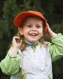 Muchacha en casquillo anaranjado Fotografía de archivo libre de regalías