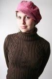 Muchacha en casquillo color de rosa Imagen de archivo libre de regalías