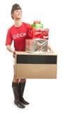 Muchacha en casquillo de ultramar con los bolsos de compras coloreados Imagen de archivo libre de regalías