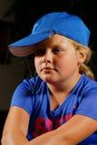 Muchacha en casquillo del deporte foto de archivo