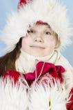 Muchacha en casquillo del invierno Fotografía de archivo libre de regalías