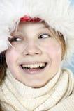Muchacha en casquillo del invierno Imagen de archivo libre de regalías