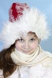Muchacha en casquillo del invierno Fotografía de archivo