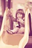 Muchacha en chaqueta en diapositiva Imagen de archivo