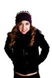 Muchacha en chaqueta y sombrero. Imagenes de archivo