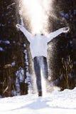 Muchacha en copos de nieve Imagenes de archivo