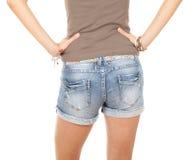 Muchacha en cortocircuitos de los pantalones vaqueros Imagenes de archivo