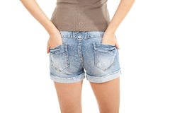 Muchacha en cortocircuitos de los pantalones vaqueros Fotos de archivo