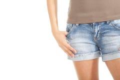Muchacha en cortocircuitos de los pantalones vaqueros Imagen de archivo libre de regalías