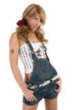 Muchacha en cortocircuitos de los pantalones vaqueros Foto de archivo libre de regalías