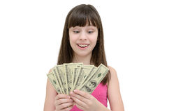 Muchacha en el asombro que sostiene el dinero en el fondo blanco Fotos de archivo