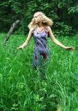 Muchacha en el bosque Fotografía de archivo