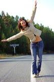 Muchacha en el camino vacío Foto de archivo libre de regalías