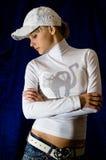 Muchacha en el casquillo blanco Imagen de archivo libre de regalías
